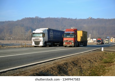 Gorj county/Romania - 27 March 2019: Volvo truck overtaking Daf truck in international transport on romanian road