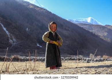 Gorkha, Nepal - December 22 2018: A Sherpa kid smiling at the camera in the remote village of Nepal
