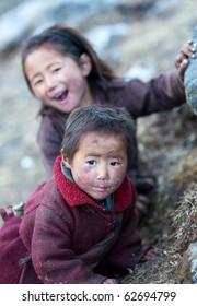 GORKHA, NEPAL - NOVEMBER 29: Two unidentified tibetan girls from village of Tibetan refugees on November 29, 2009 in Gorkha District, Manaslu Area, Nepal