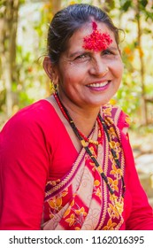 Gorkha,Nepal - Sep 30,2017: Portrait of a Happy Nepali woman after receiving Tika at dashain festival in the village of Nepal.