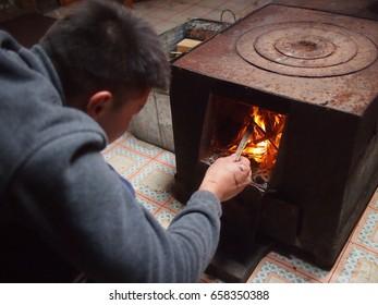 Gorkhi Terelj National Park, Mongolia - 29 September, 2016: A local Mongolian man lights a fire inside the traditional ger