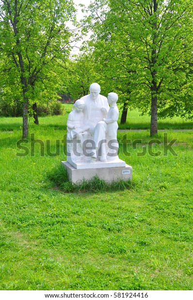 "GORKI LENINSKIE, RUSSIA - MAY 11, 2016: Sculpture of Nicholas Shcherbakov ""Lenin and children"" in the Museum-Reserve Lenin's Hills.This sculpture was made of marble in 1966"