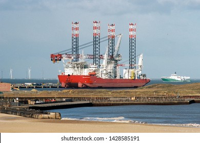 GORLESTON, NORFOLK,  ENGLAND - March 2019: Seajacks Scylla wind turbine installation vessel moored in Great Yarmouth Outer Harbour, i n Norfolk, England