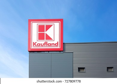 Gorlice, Poland - 30 September 2017: Sign of the Kaufland hypermarket on the blue sky in a sunny day. Kaufland is a German international distribution hypermarket network.