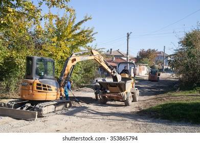 Gorna Oryahovitsa -Noemvri 4: Construction Site-Repair Plumbing and construction of additional drainage manholes. Workers and road construction machines of November 4 2015, Gorna Oryahovitsa, Bulgaria