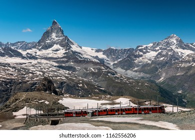 Gornergrat tourist train with Matterhorn mountain in the background. Valais region, Zermatt, Switzerland.