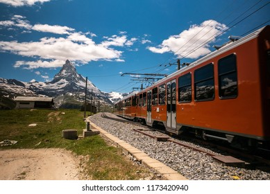 Gornergrat tourist train with Matterhorn mountain in the background. Valais region, Zermatt, Switzerland.