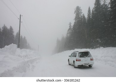 GORNIY, RUSSIA - MARCH 23, 2009: Subaru Forester on winter forest road during snow storm