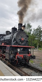 Gornyj Park Ruskeala, Republic of Karelia / Russia - 06 21 2019: A retro locomotive