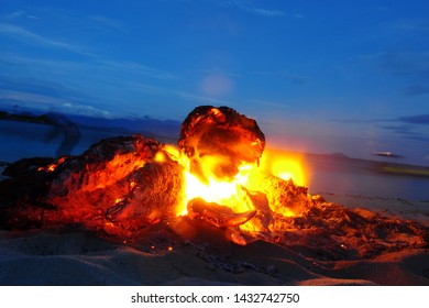 Gorontalo, Indonesia. August 24,2014. make fire on the beach while waiting for fishermen to bring fish catches