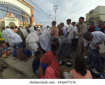 Gorontalo, Indonesia - June 5 2019: Eid al-Fitr tradition before eid prayer, Sadaqah money to poor people