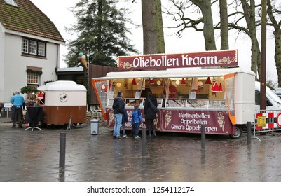 Gorssel, The Netherlands - December 11, 2016: People buying oliebollen, traditional sweet pastry for the celebration of the new year, from a stand in the street