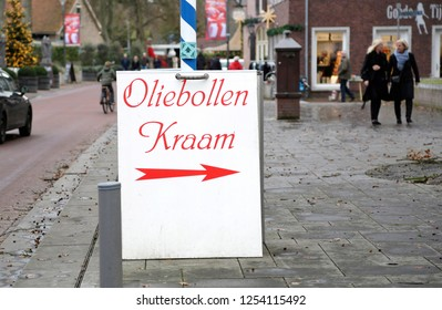 Gorssel, The Netherlands - December 11, 2016: A sign with directions to a  oliebollen stand for traditional sweet pastry for the celebration of the new year