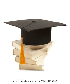 Gortarboard and book, isolated on white