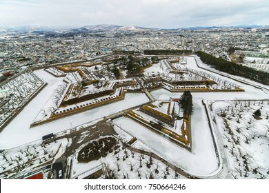 Goryokaku park covered snow in winter with blurred cityscape background in Hakodate, Hokkaido ,Japan. Selective focus.