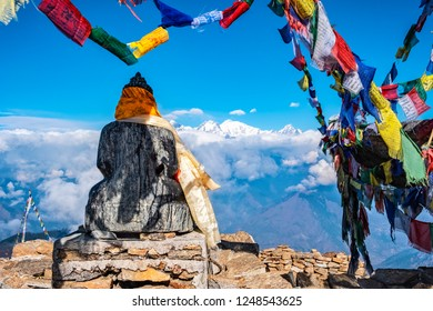 GOSAINKUNDA, NEPAL - NOVEMBER 14, 2018: Scenic situated buddha statue, decorated and surrounded from prayer flags.