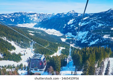 GOSAU, AUSTRIA - FEBRUARY 26, 2019: Panorama Jet Zwieselalm cable car is nice place to ride and enjoy the scenery of Dachstein West Alps, on February 26 in Gosau