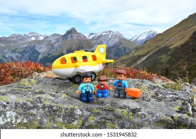 Gosau, Austria – October 12th 2019: Lego family traveling in the Alps, Lego is a popular line of construction toys manufactured by the Lego Group