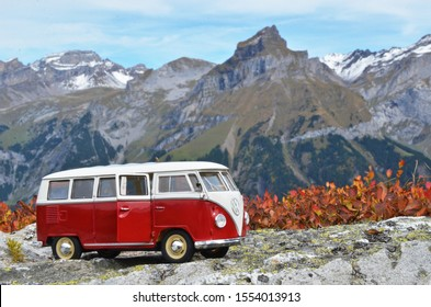 Gosau, Austria – October 12th 2019: Miniature VW Bulli 1962 in the mountains. The cult car of the Hippie generation and it remained the status vehicle of all travelers