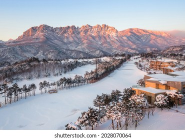 Goseong-gun, Gangwon-do, South Korea - January 21, 2017: Panoramic and morning view of snow covered Delfino Golf and Resort against Ulsanbawi Rock of Seoraksan National Park