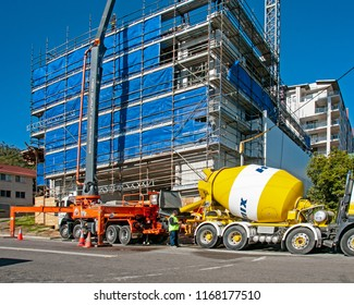 Gosford, New South Wales, Australia - July 7. 2018: Construction and building progress update 104.  Pumping concrete on new home units building site, at 47 Beane St.