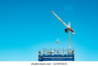 Gosford, New South Wales, Australia - August 29. 2018: Construction and building progress update 121.  A working tower crane on new home units building site at 47 Beane St.