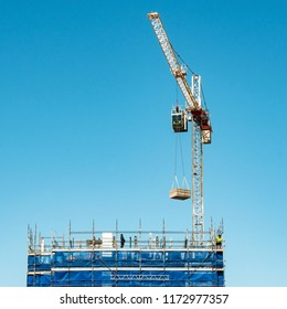 Gosford, New South Wales, Australia -August 29. 2018: Construction and building progress update 120.  A working tower crane on new home units building site at 47 Beane St.