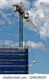 Gosford, New South Wales, Australia - November 8, 2018: A working tower crane on new home units building site at 47 Beane St. Construction and progress
