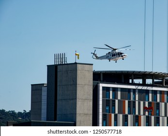 Gosford, New South Wales, Australia - August 30, 2018:  Helicopter Air Ambulance care flight arriving at the new wing helipad of Gosford Hospital. Construction progress update H22ed.