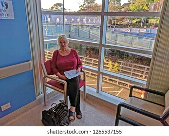 Gosford, New South Wales, Australia - October 23, 2018: Senior lady patient seated in the Cardiac waiting room of the new wing of Gosford Hospital. Progress Update H56ed.