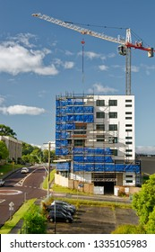 Gosford, New South Wales, Australia - February 23, 2019:  A working tower crane on new home units building site at 47 Beane St.  Update 189.