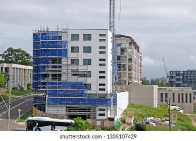 Gosford, New South Wales, Australia - February 27 , 2019: Removing safety netting on new home units building site at 47 Beane St. Construction and building progress Update 190