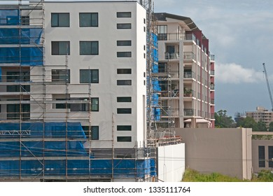 Gosford, New South Wales, Australia - February 27 , 2019: Removing safety netting on new home units building site at 47 Beane St. Construction and building progress Update 191