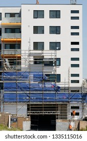 Gosford, New South Wales, Australia - march 4, 2019: Disassembling scaffolding and removing safety netting on new home units building site at 47 Beane St. Construction progress Update 193