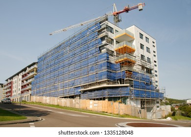 Gosford, New South Wales, Australia - March 5, 2019:  A perspective view of a working tower crane on new home units building site at 47 Beane St.  Update 196.