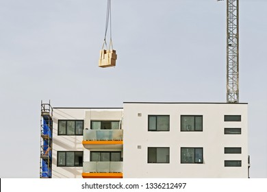 Gosford, New South Wales, Australia - March 6, 2019:  A working tower crane delivering materials, on new home units building site at 47 Beane St.