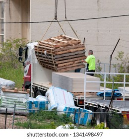 Gosford, New South Wales, Australia - December 18, 2018: Workmen close up, delivering building supplies for new home units building site at 47 Beane St. Construction update