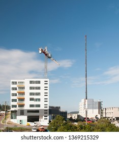 Gosford, New South Wales, Australia - April  9, 2019:  The disassembly of a tower crane from new home units building construction site at 47 Beane St.  Update ed300.