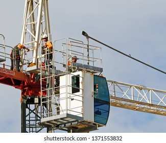 Gosford, New South Wales, Australia - April  9, 2019: The disassembly of a tower crane from new home units building construction site at 47 Beane St. Update ed306.