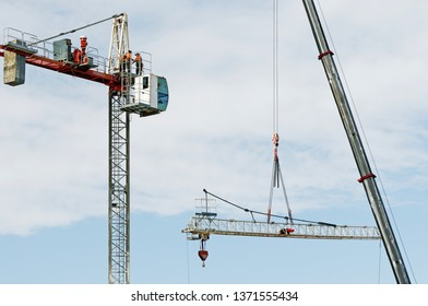 Gosford, New South Wales, Australia - April  9, 2019: The disassembly of a tower crane from new home units building construction site at 47 Beane St. Update 307ed.