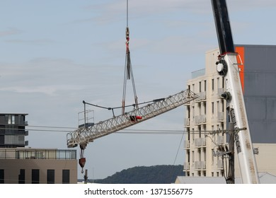 Gosford, New South Wales, Australia - April  9, 2019: The removal of a tower crane from new home units building construction site at 47 Beane St. Update ed308.