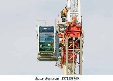 Gosford, New South Wales, Australia - April  9, 2019: The dismantle of a tower crane from new home units building construction site at 47 Beane St. Update ed309.
