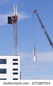 Gosford, New South Wales, Australia - April  9, 2019: The disassembly of a tower crane from new home units building construction site at 47 Beane St. Update ed311.