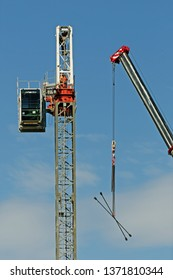 Gosford, New South Wales, Australia - April 9, 2019: The disassembly of a tower crane from new home units building construction site at 47 Beane St. Update ed313.