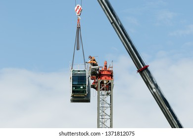 Gosford, New South Wales, Australia - April 9, 2019: The disassembly of a tower crane from new home units building construction site at 47 Beane St. Update ed315.