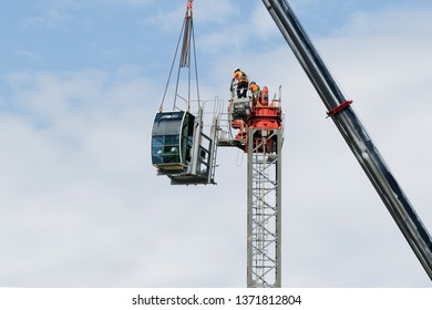 Gosford, New South Wales, Australia - April 9, 2019: The disassembly of a tower crane from new home units building construction site at 47 Beane St. Update ed316.