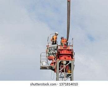 Gosford, New South Wales, Australia - April 9, 2019: The disassembly of a tower crane from new home units building construction site at 47 Beane St. Update ed317.
