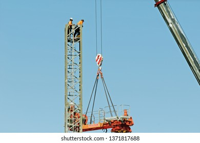 Gosford, New South Wales, Australia - April  9, 2019: The disassembly of a tower crane from new home units building construction site at 47 Beane St. Update ed319.
