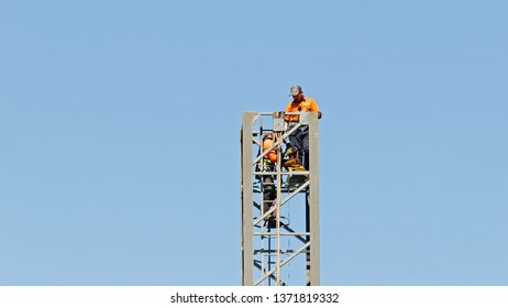 Gosford, New South Wales, Australia - April  9, 2019: The disassembly of a tower crane from new home units building construction site at 47 Beane St. Update ed321.