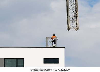 Gosford, New South Wales, Australia - April  9, 2019: The disassembly of a tower crane from new home units building construction site at 47 Beane St Update ed324.